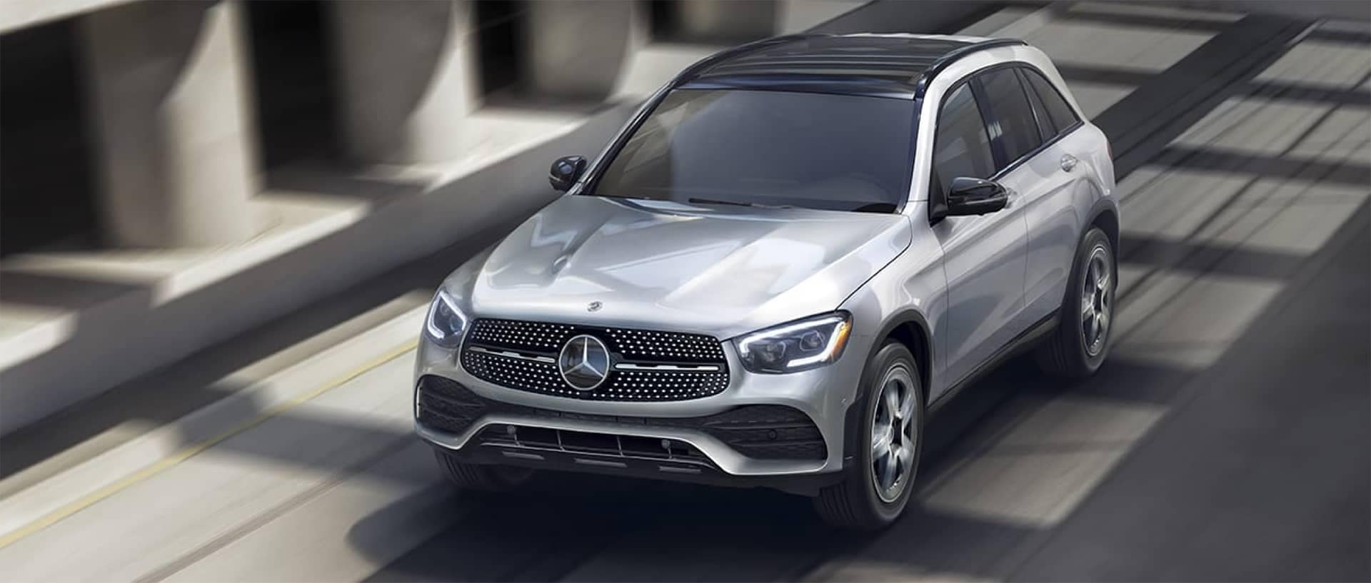Mercedes-Benz SUV driving down road