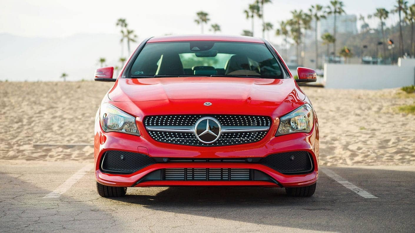 picture of red Mercedes-Benz CLA parked on the beach