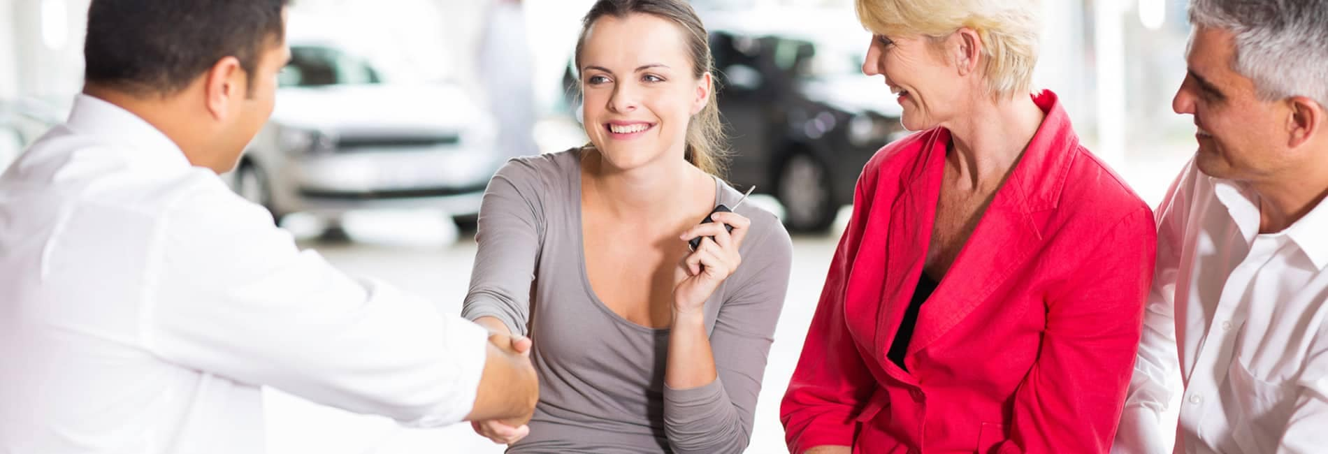 picture of woman shaking hands will salesman