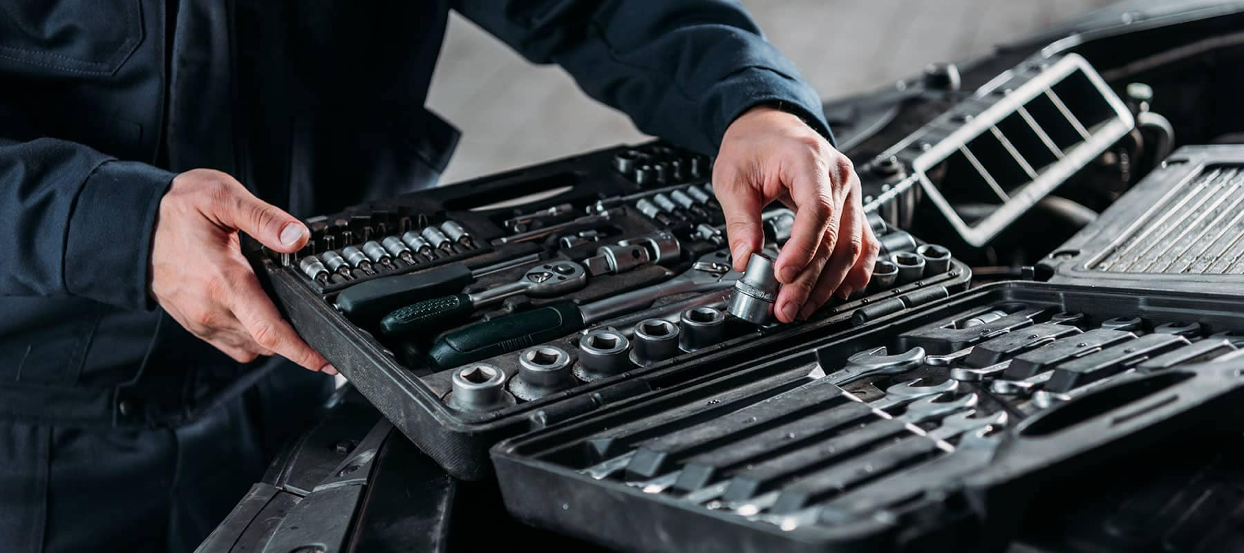 picture of service technician's hands pulling tools out of toolbox