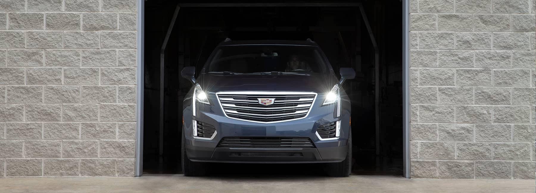 A Cadillac exiting a garage