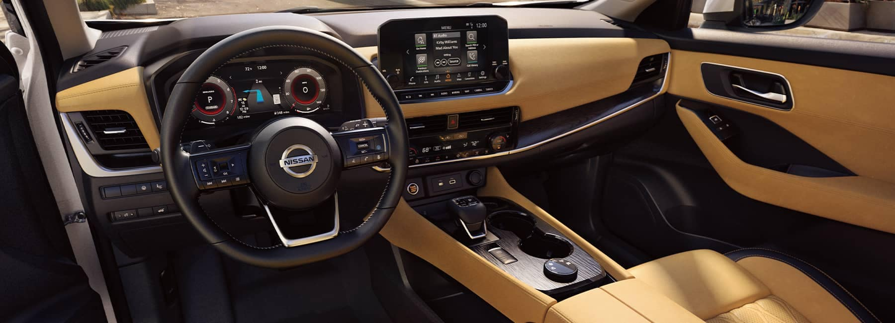 The black and tan leather interior of a 2021 Nissan Rogue