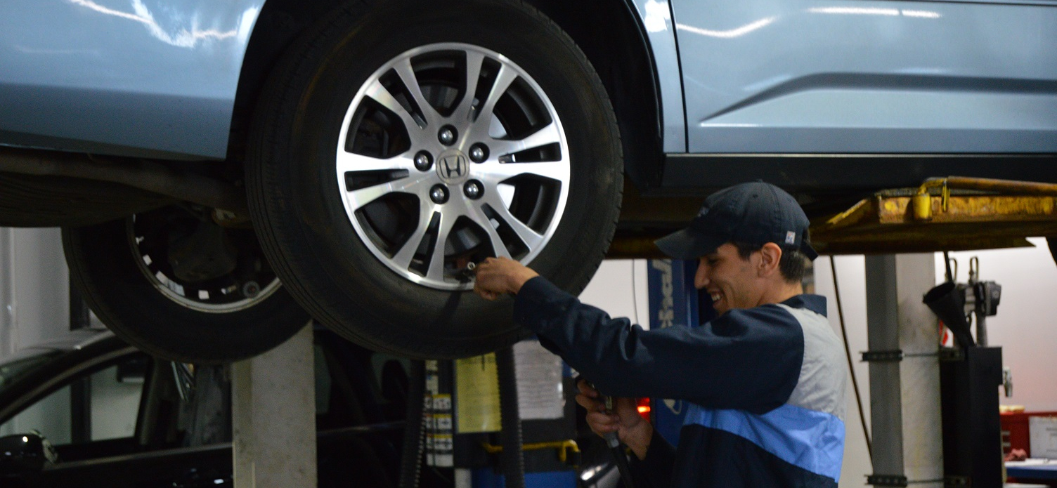 Man Working on a Honda Tire