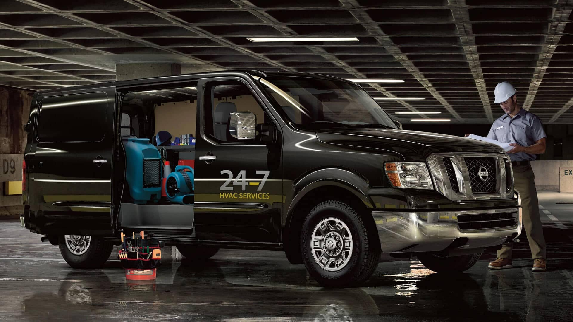 2020 Nissan NV Cargo with side door open showing tool shelves on the inside