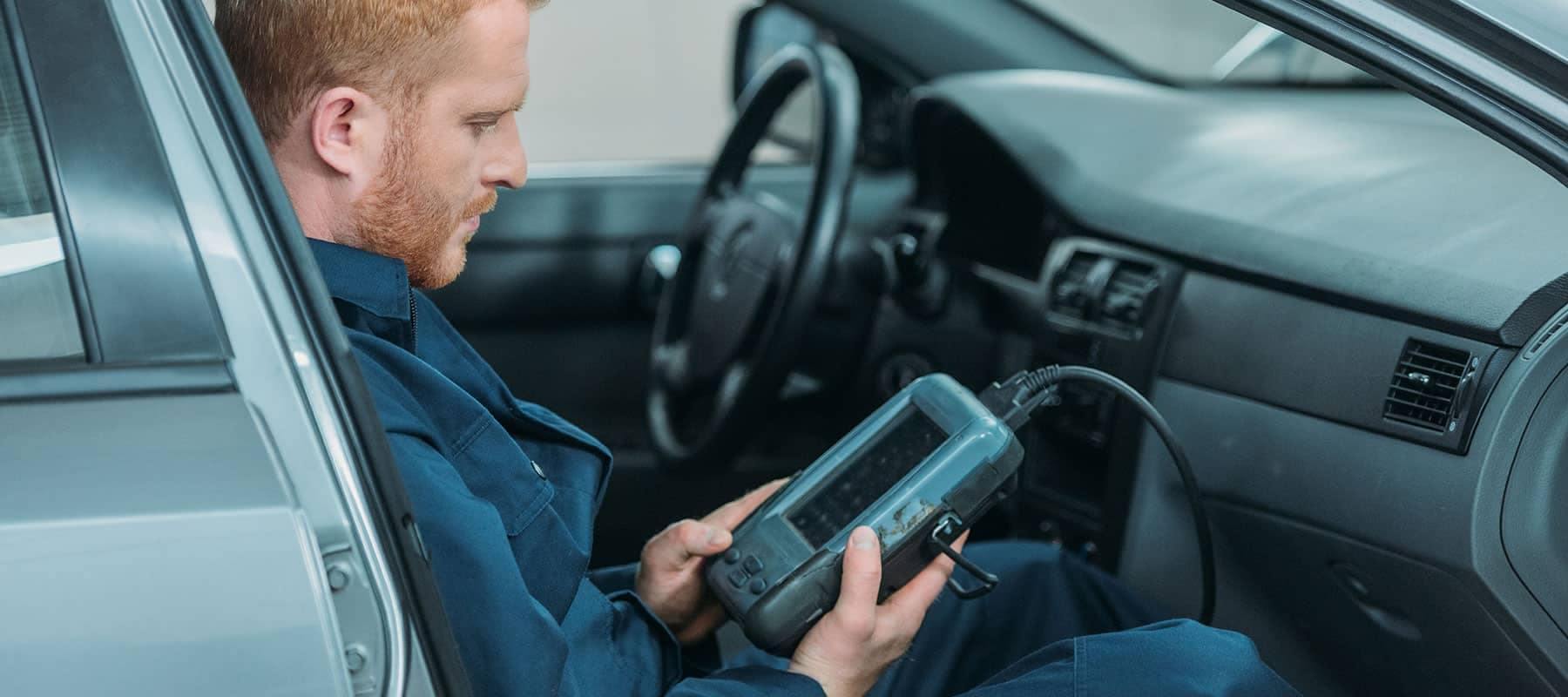 Diagnostic picture of technician looking up car readings