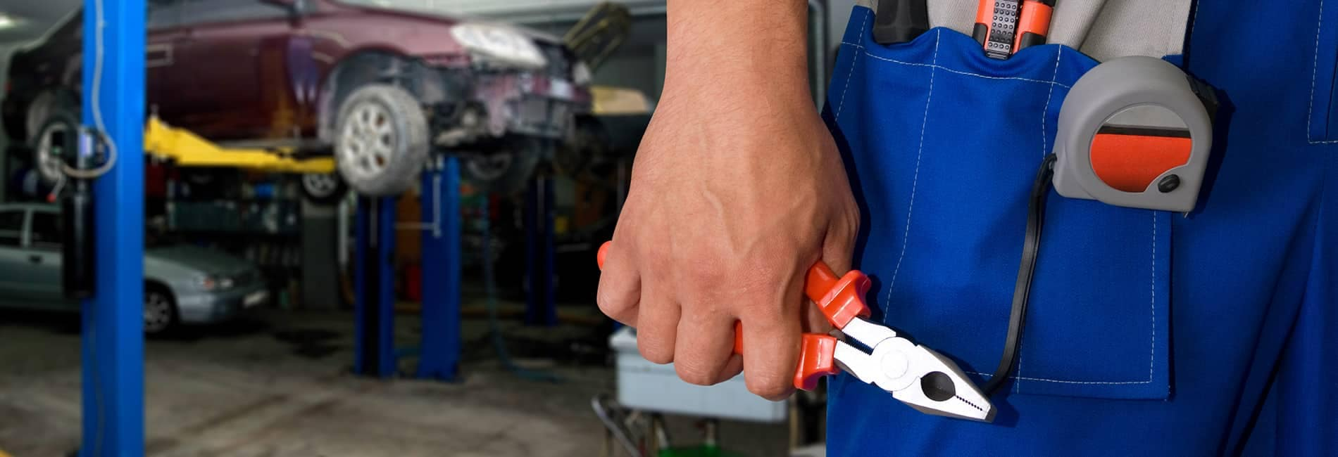 Tool picture of technician's hand holding pliers