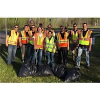 group photo of Adopt a Highway team wearing reflective vests