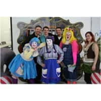 group photo with some dressed as clowns with clown makeup