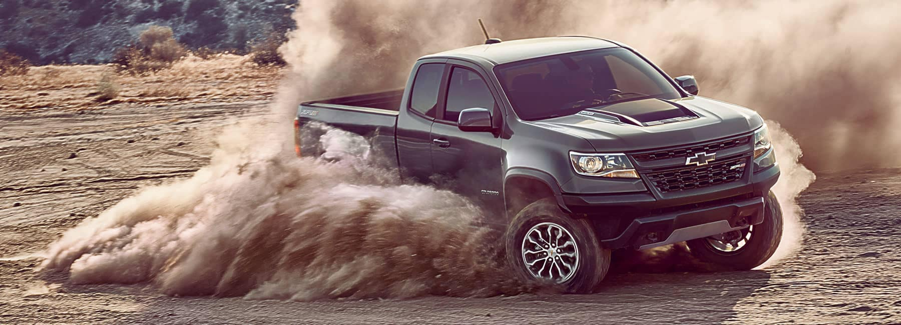 Chevrolet truck driving on a dirt road