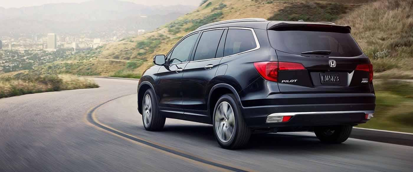 2018 Honda Pilot driving around a curved road