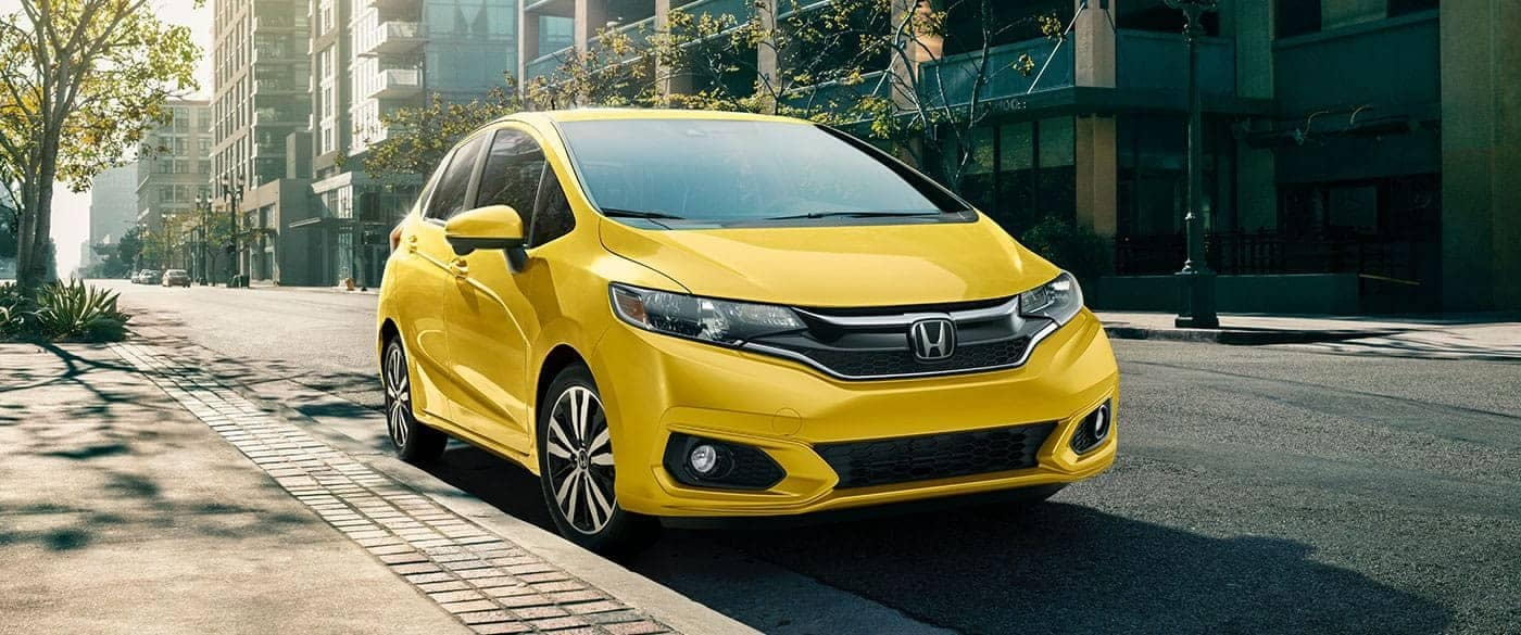 Yellow 2018 Honda Fit parked on side of street