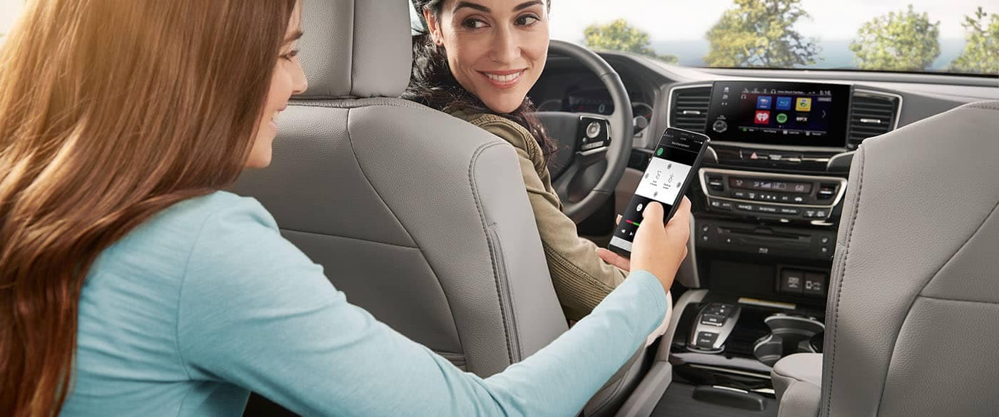 2019 Honda Pilot girl in backseat controling cabin features