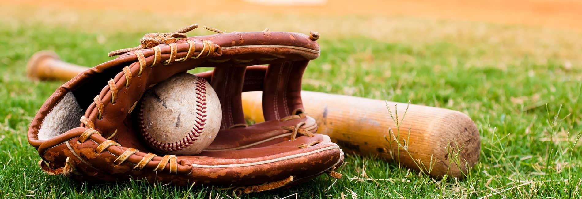 Baseball Glove, Bat and Ball on the Field