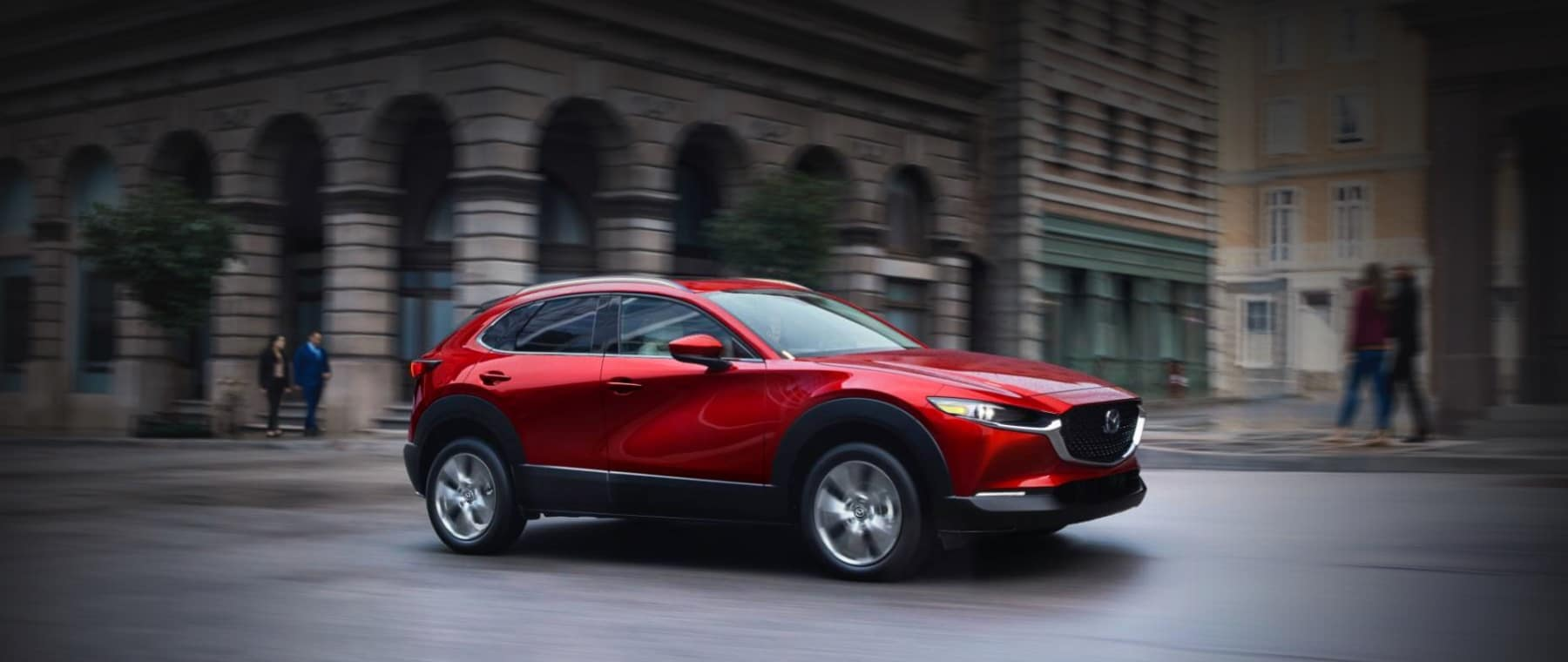 red Mazda SUV parked