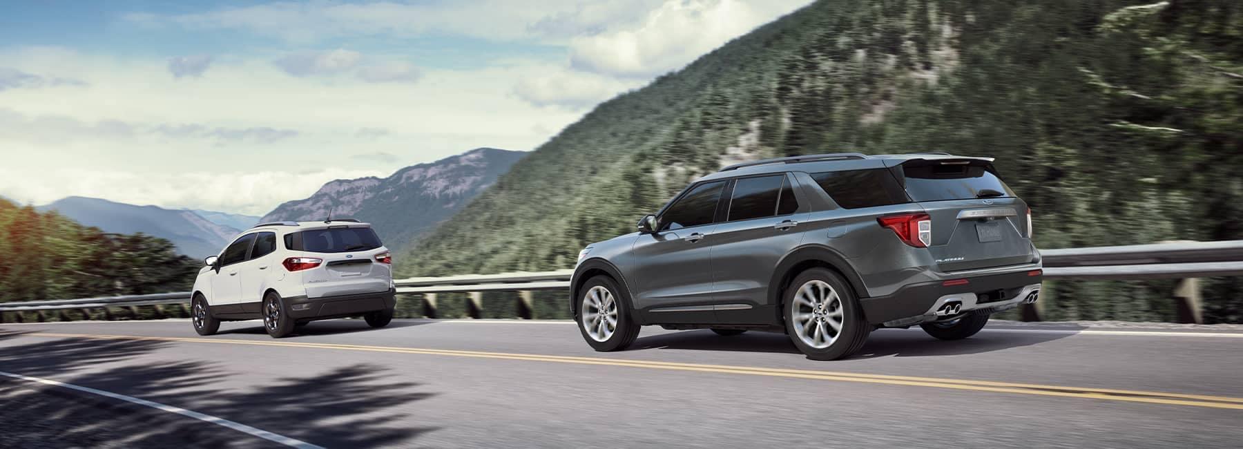 Grey 2021 Ford Explorer driving through a mountain pass