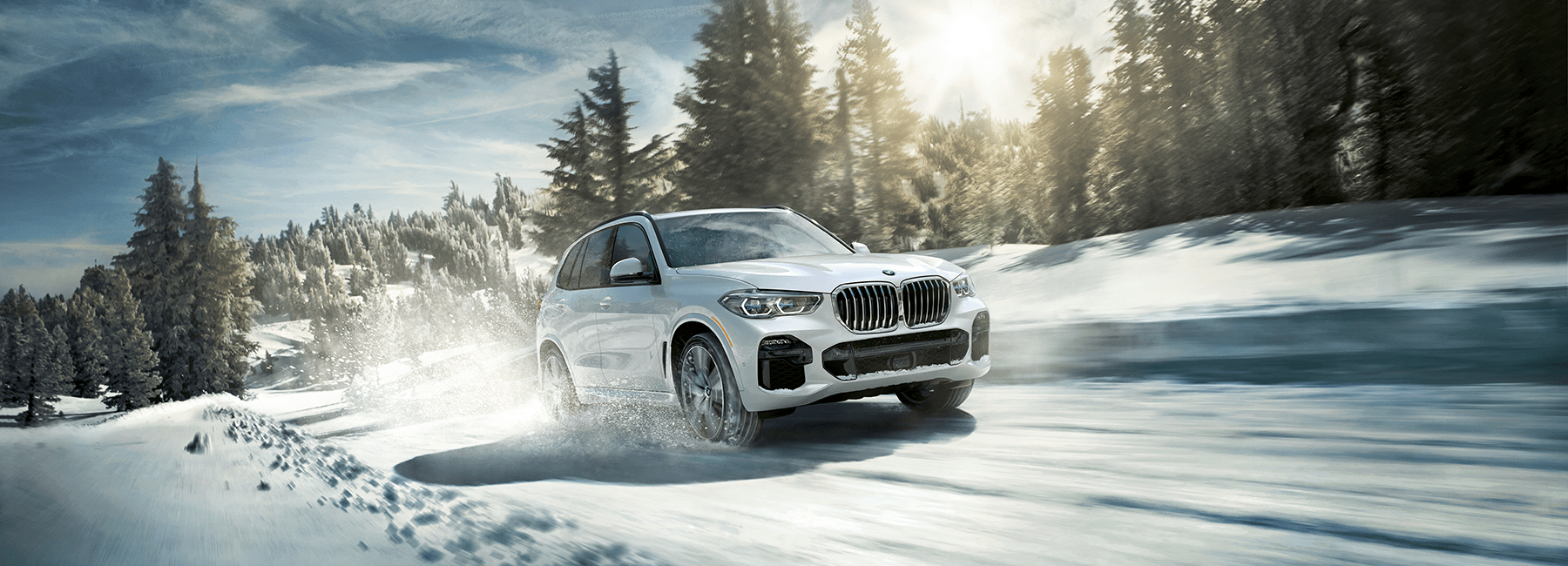 A white BMW X5 handles well over snow