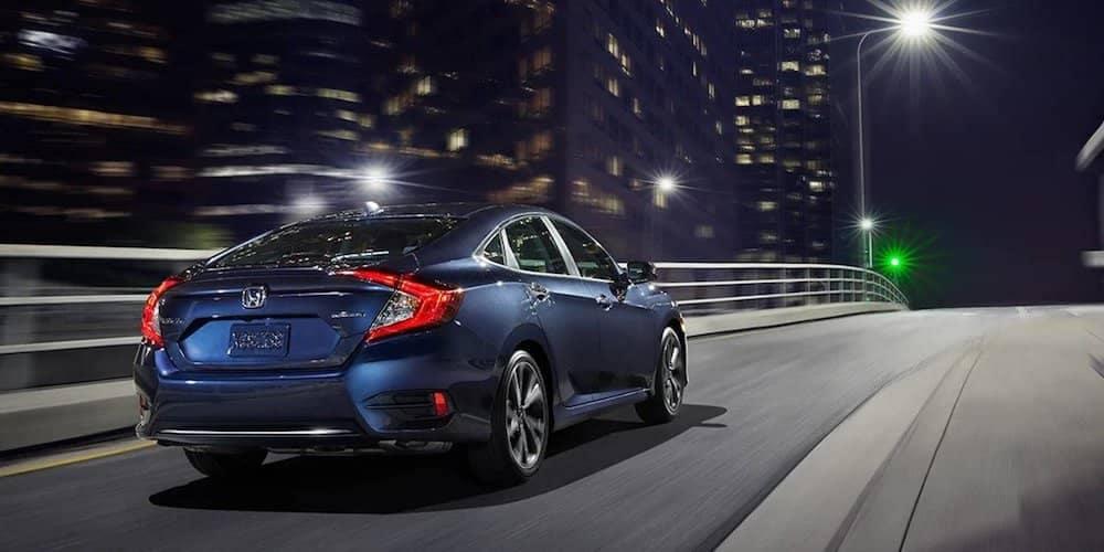 2021 Honda Civic driving through the city at night