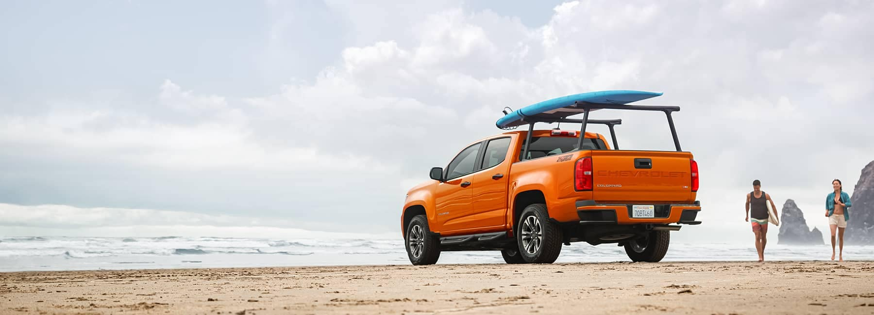 Orange Chevrolet Truck on the beach