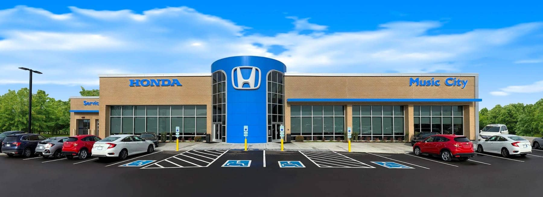 An exterior shot of a Honda dealership.