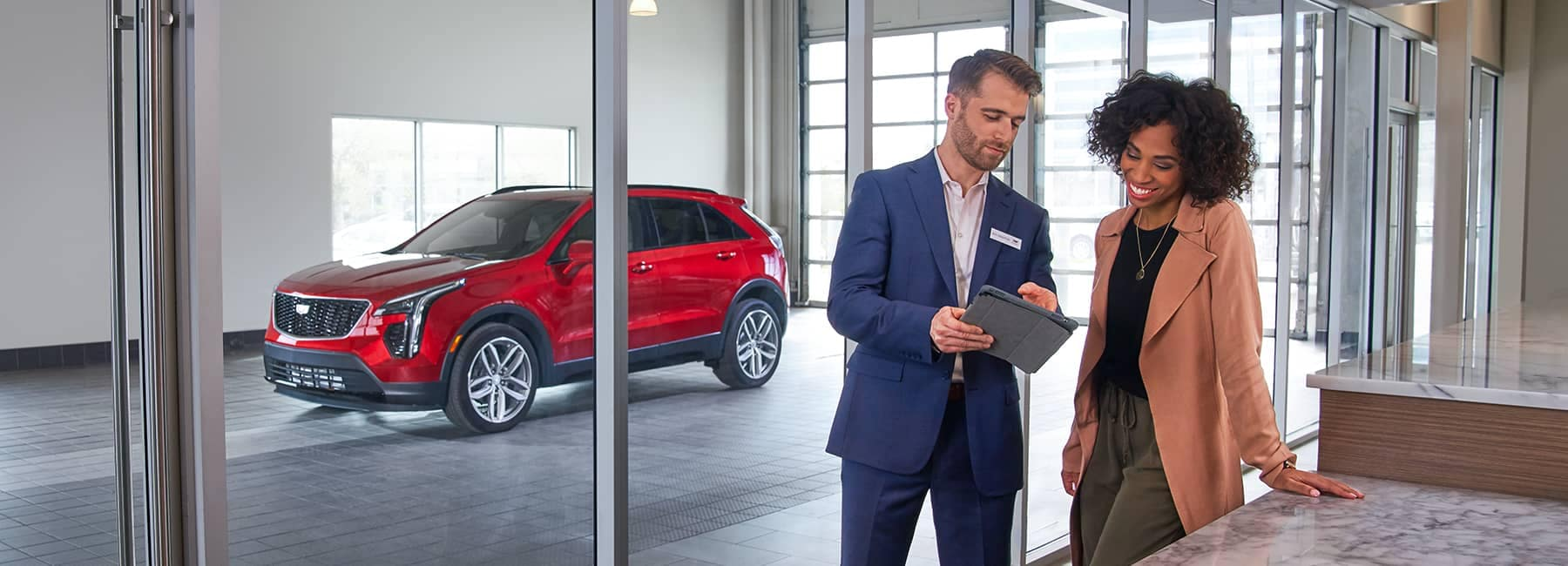 A Sales Rep with a customer in a dealership