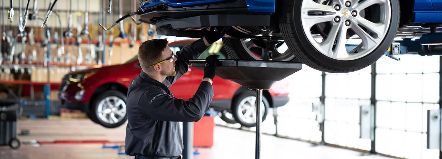 A mechanic working under a car