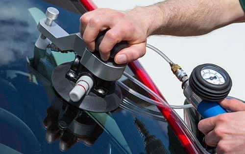 Mechanic working on windshield