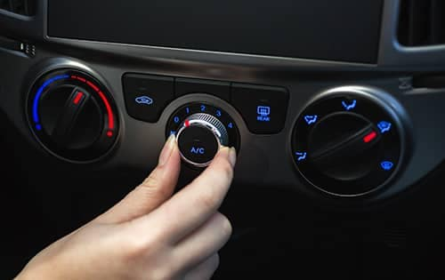 Person adjusting car AC