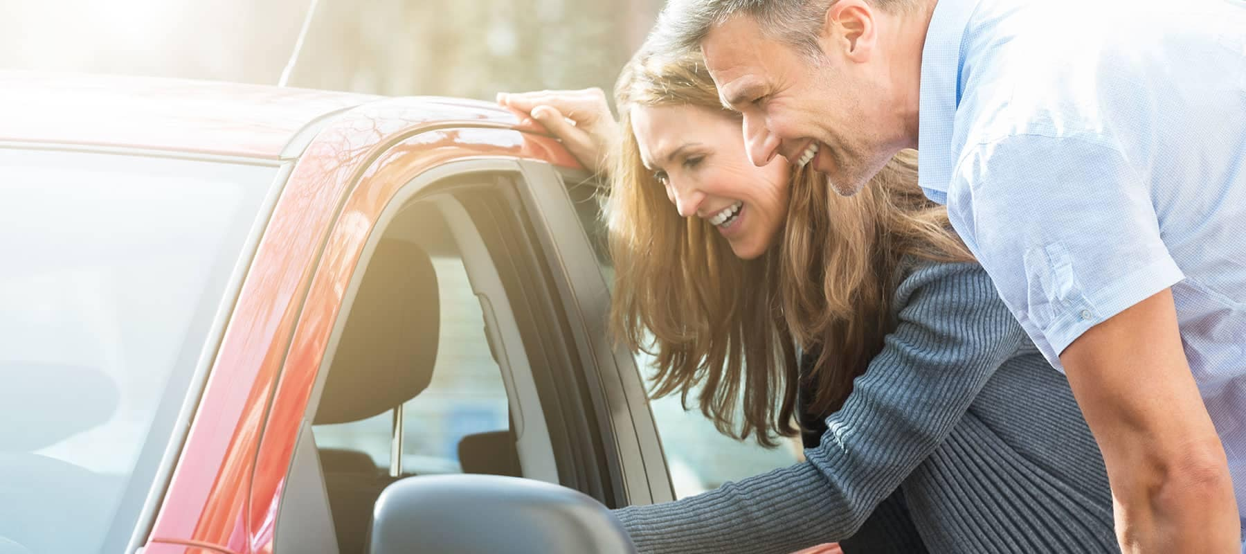 Couple looking at used car