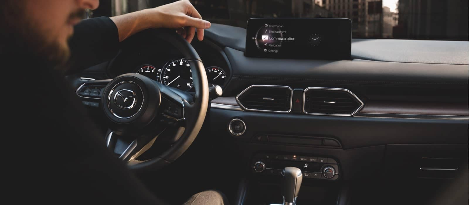 2021 Mazda CX-5 interior with driver2