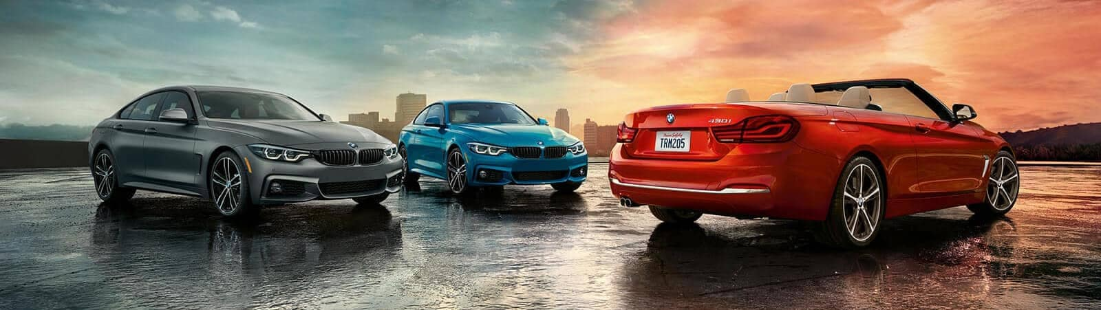 BMW 4Series convertibles in front of city skyline