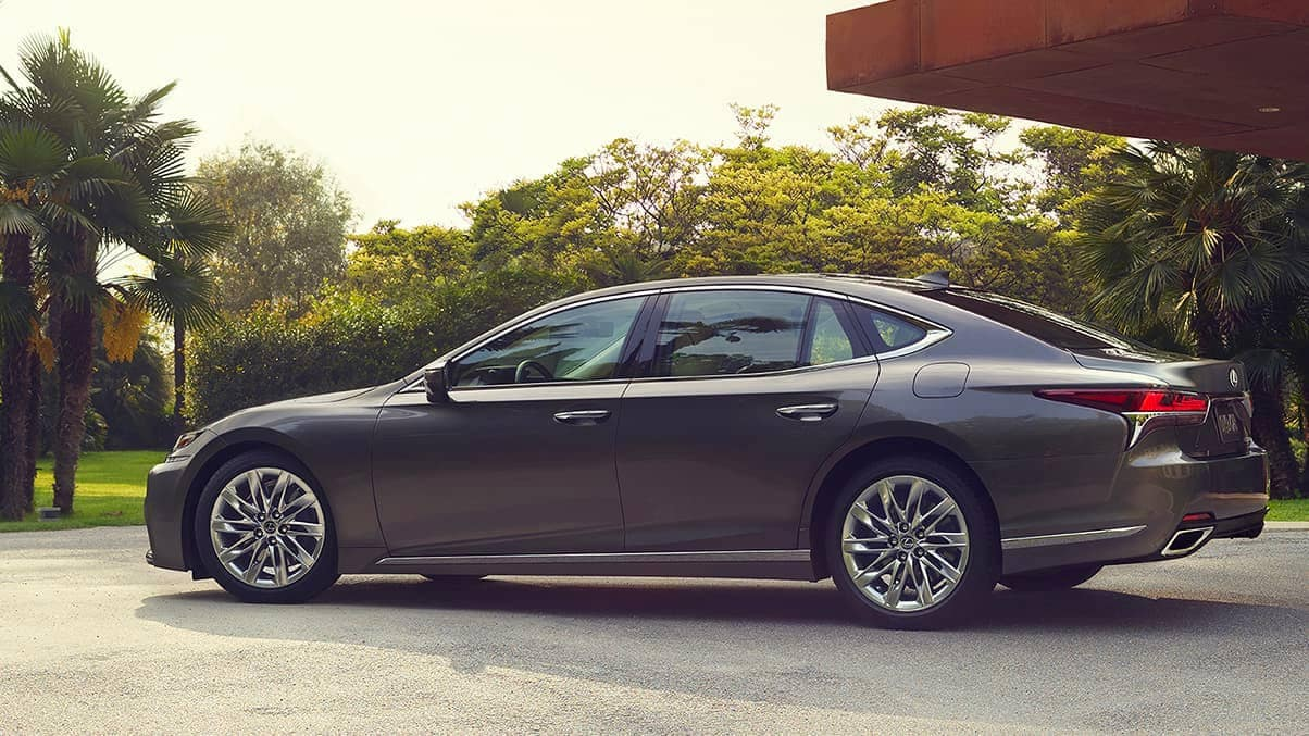 2020 Lexus LS parked in back yard by palm trees