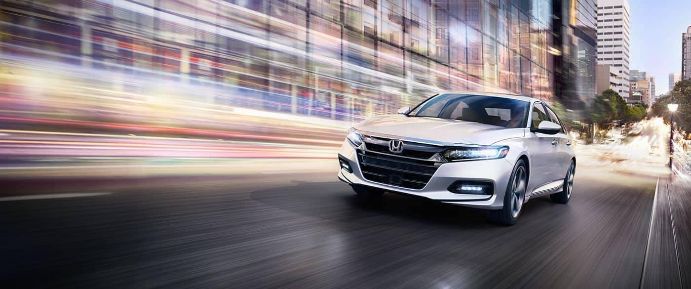 2018 Honda Accord Sedan Driving Down A City Street