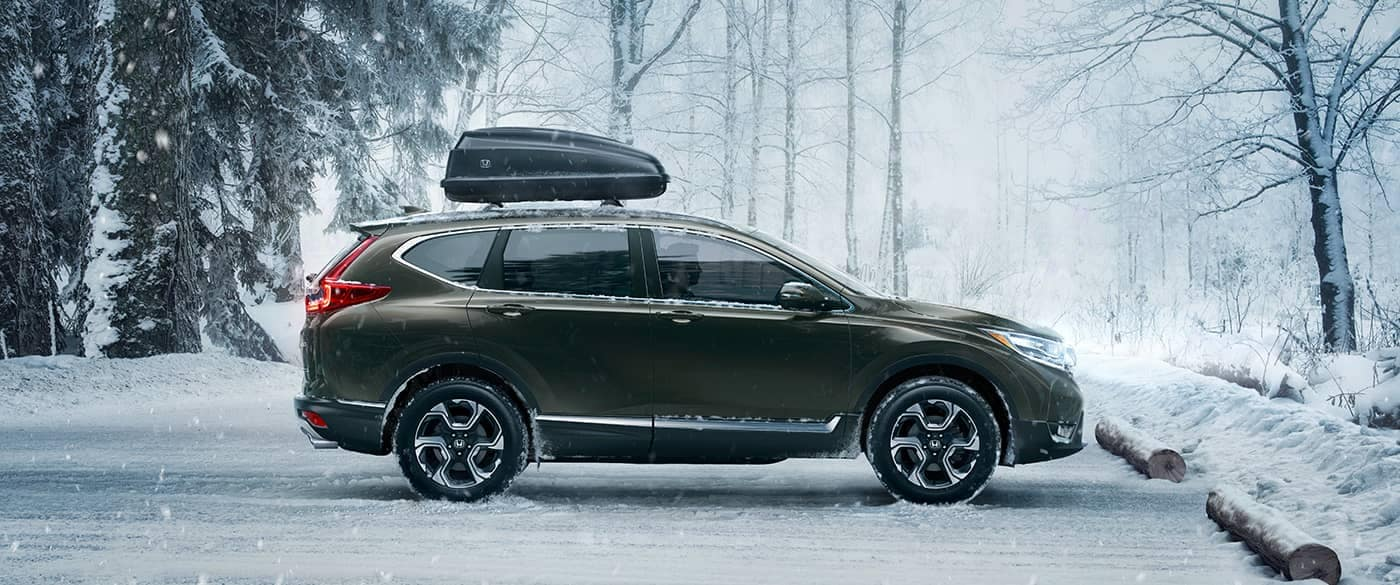 2018 Honda CR-V parked in the snow with equipment on the roof rails
