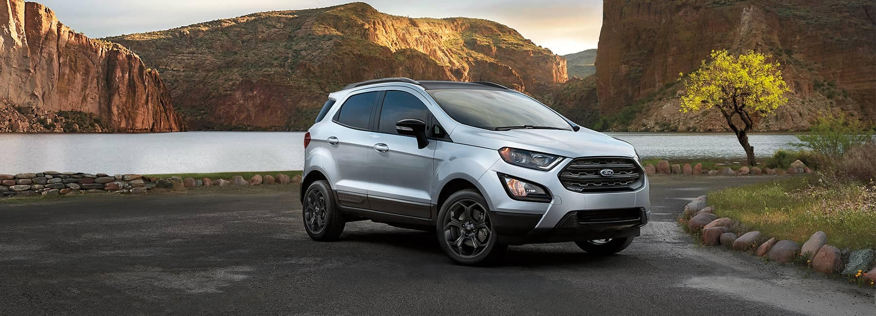 Silver 2021 Ford EcoSport parked on a river overlook in a canyon