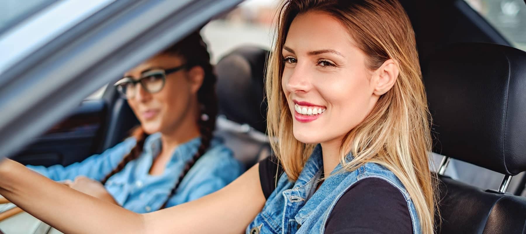 two women in car smiling