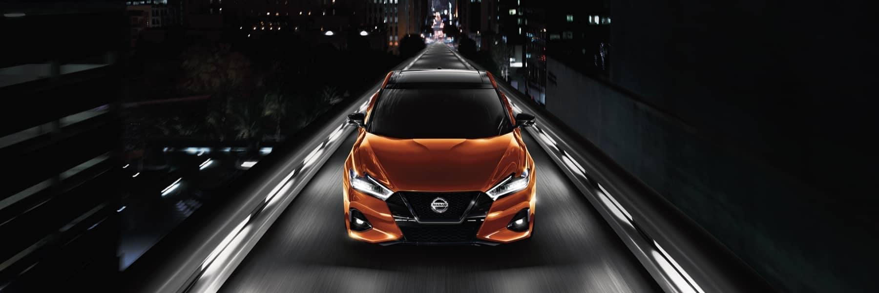 Nissan orange sedan hero-bg