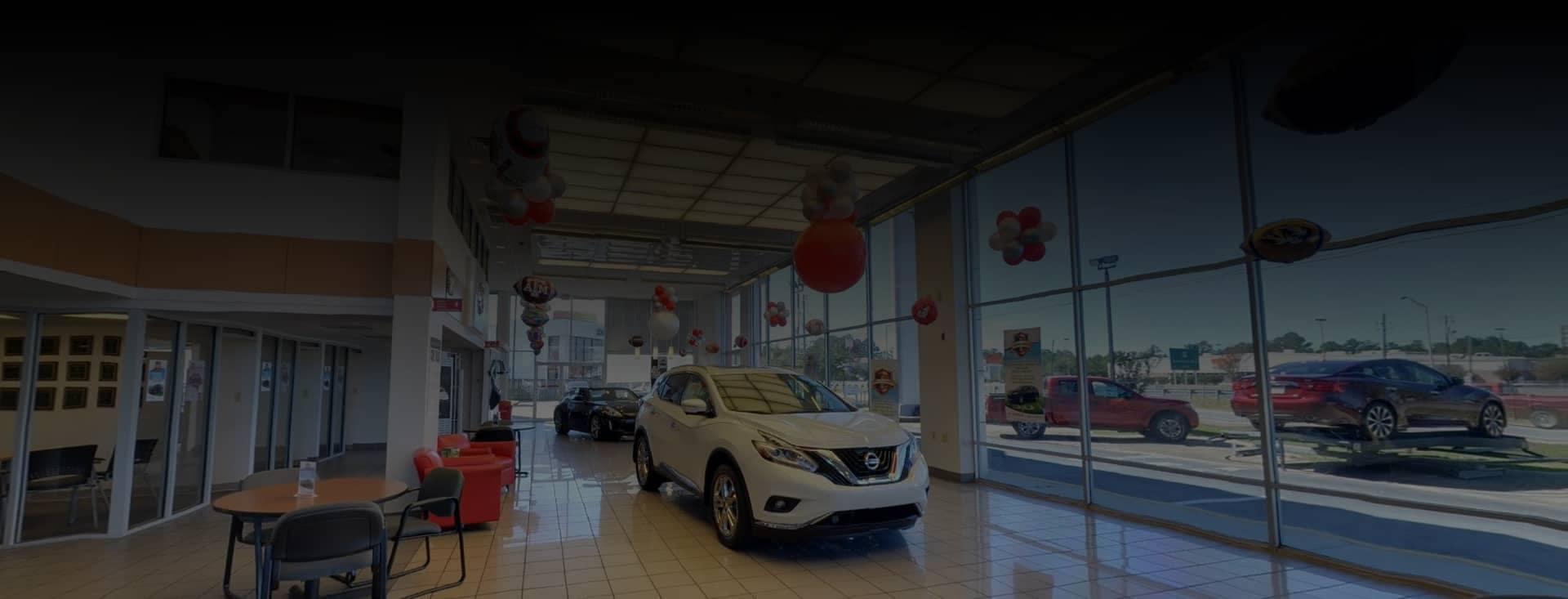 Nissan of Mobile dealership showroom