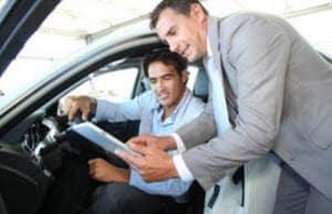 Car Dealership Looking at Papers