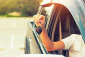 Women Holding Car Keys
