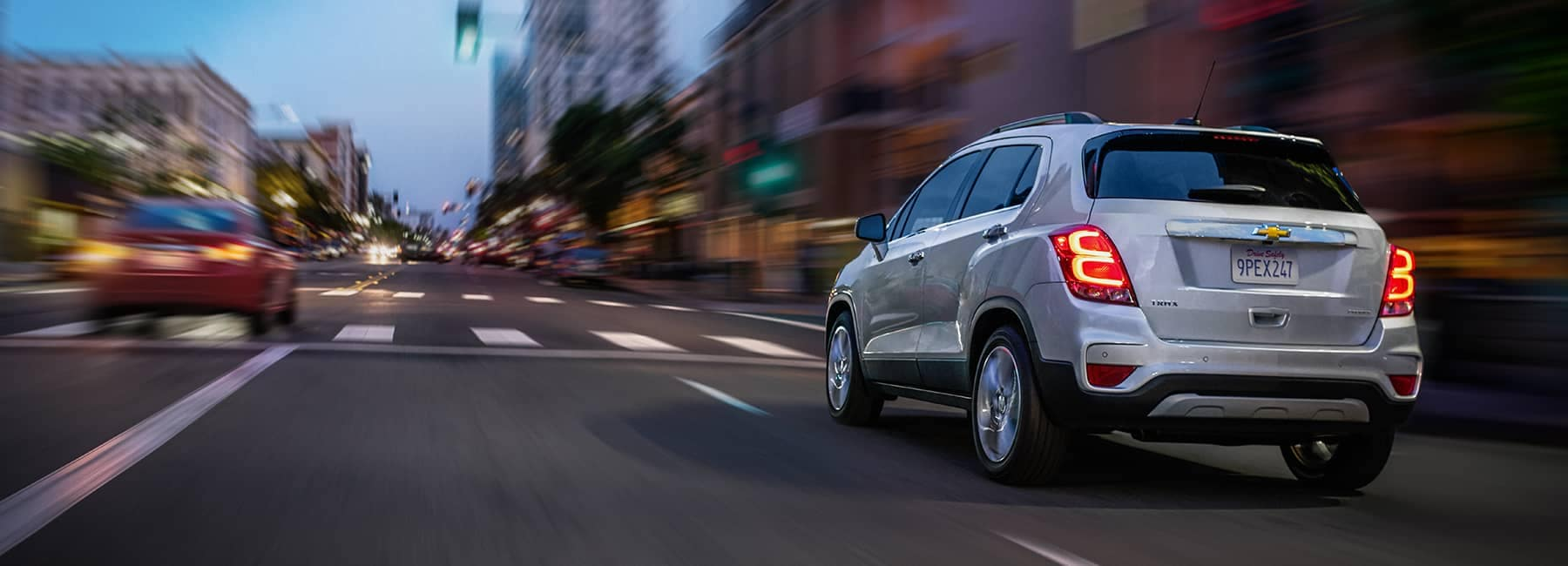 Silver 2020 Chevrolet Trax Driving on a City Rd_mobile