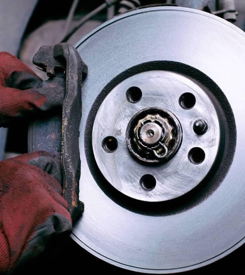 Service tech working on brakes
