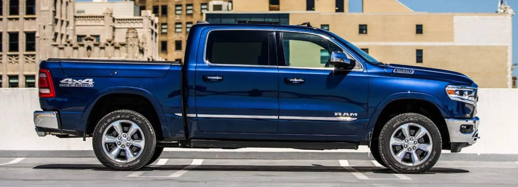 Ram 1500 Limited in blue sideview