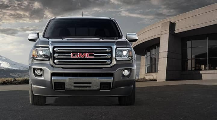 Grey 2020 GMC Canyon Font parked in front of a cement building