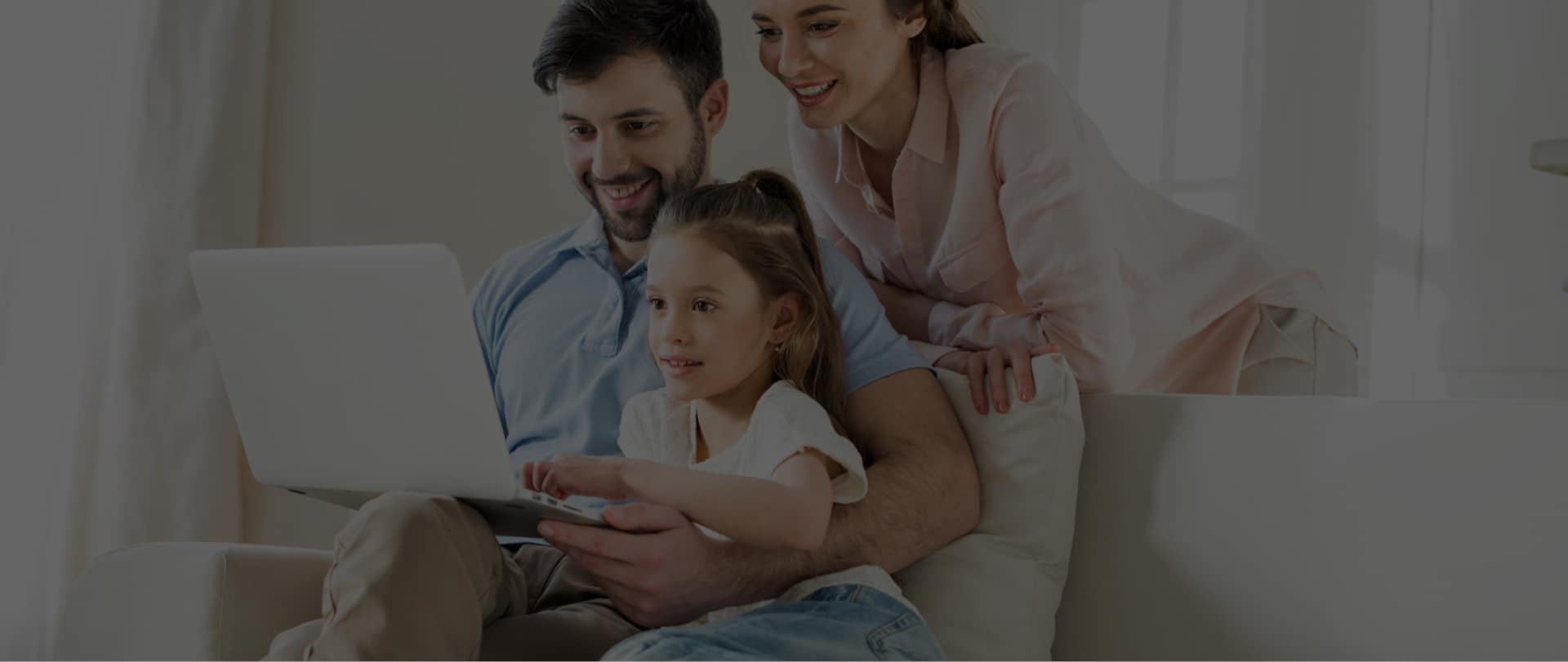 image of a family shopping for a car on a laptop