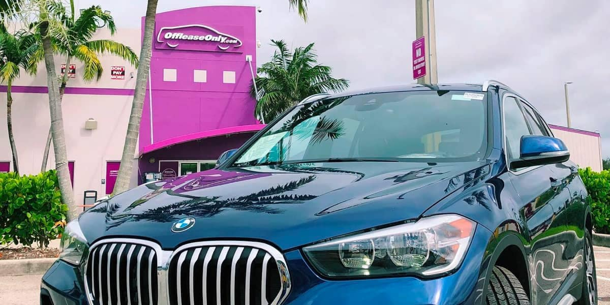 BMW parked in front of an Off Lease Only dealership