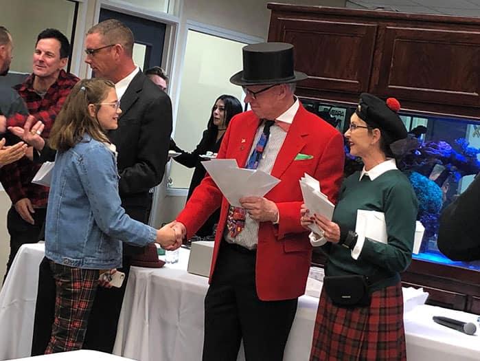 Man in top hat shaking hands