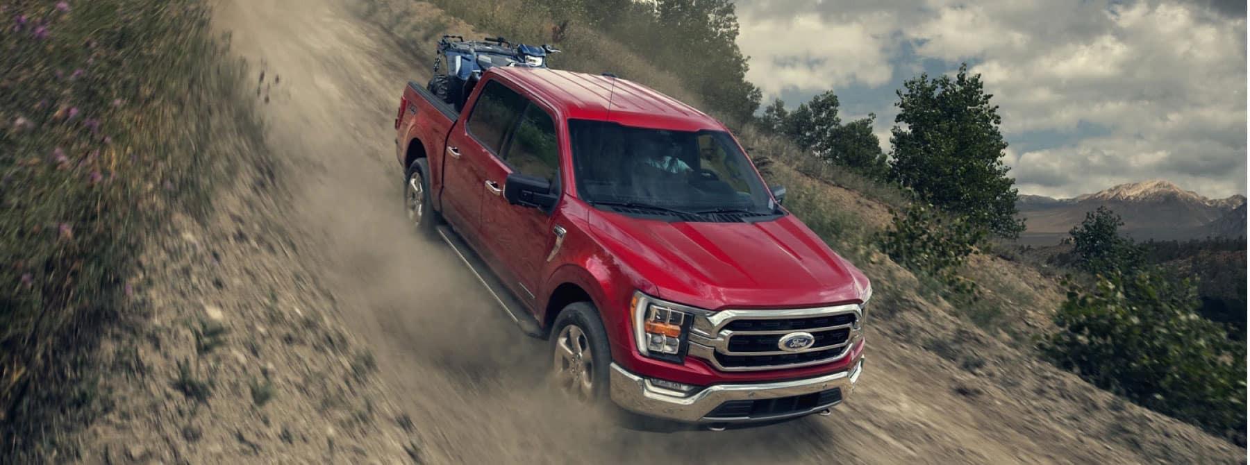 Truck driving down dirt road