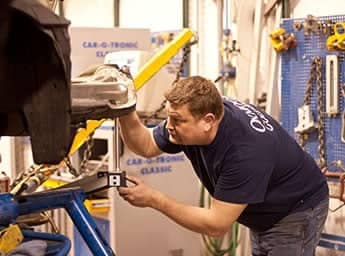 Technician perfomring frame repair