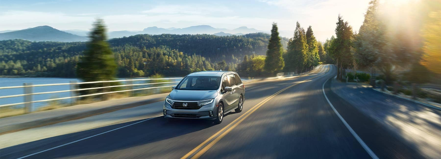 Honda Odyssey driving near lake