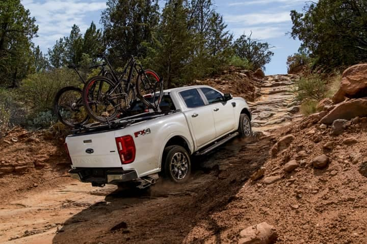 2019 Ford Ranger driving up rocky dirt hill